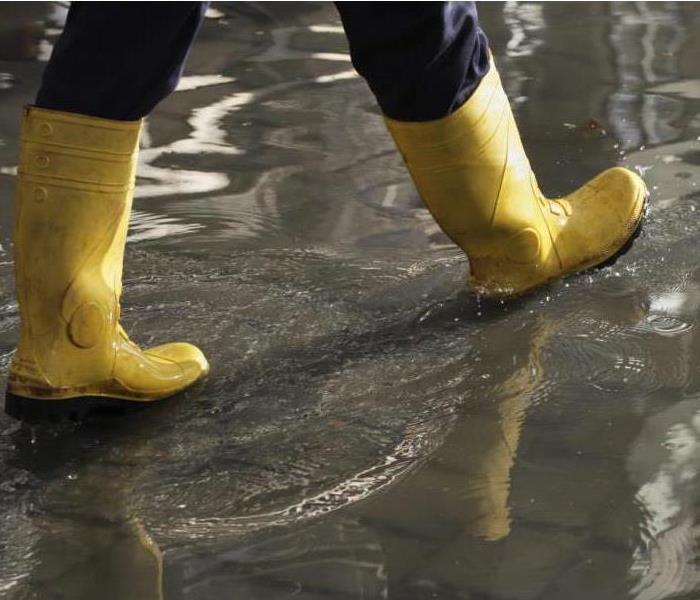 person in rubber boots